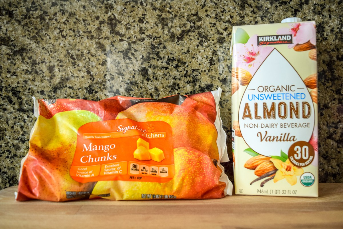 Ingredients for Two-Ingredient Almond Mango Ice Cream: frozen mango chunks and almond milk