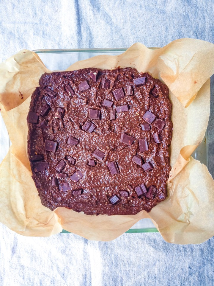 An overhead shot of oil-free brownies in a baking dish before baking