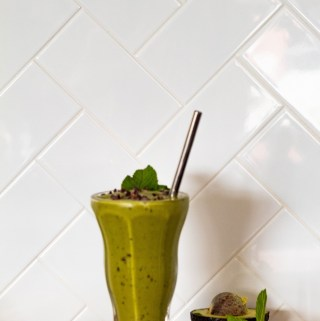 Matcha Avocado Mint Chip Shake, made with banana, avocado, mint, matcha, and cacao nibs.