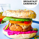 a pinterest graphic with the title of the post and a photo of the breakfast sandwich on a blue plate