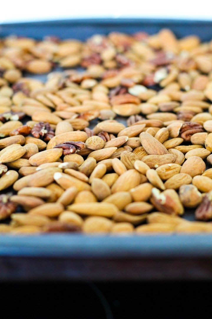 Cinnamon Pecan Almond Butter recipe: roasted nuts on a cookie sheet to be used in the nut butter