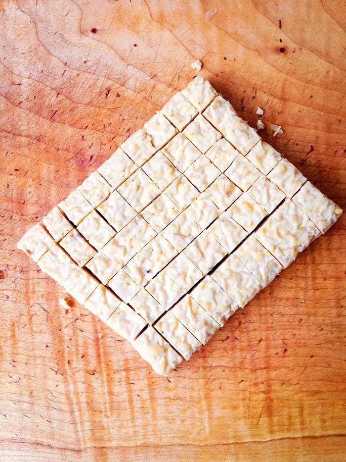 Diced tempeh, a central ingredient in the tempeh, mushroom, and sweet potato empanadas
