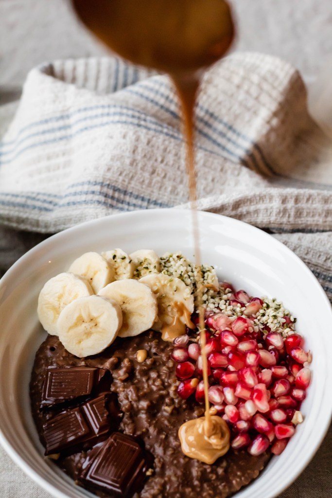 Vegan Chocolate Steel Cut Oatmeal with Peanut Butter, Pomegranate, and Banana
