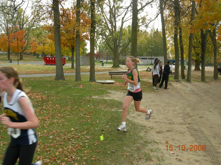 A photo of Allison running cross country in high school