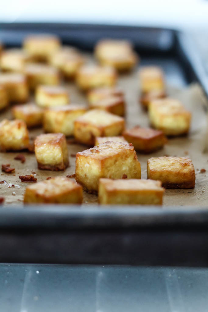 the prepared crispy baked tofu shown on a baking sheet