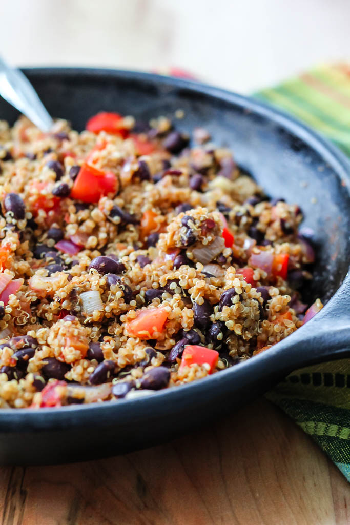 a shot of the black bean and quinoa mixture in a cast iron skillet