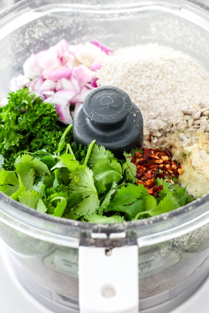 all the falafel ingredients are shown in a food processor before being blended