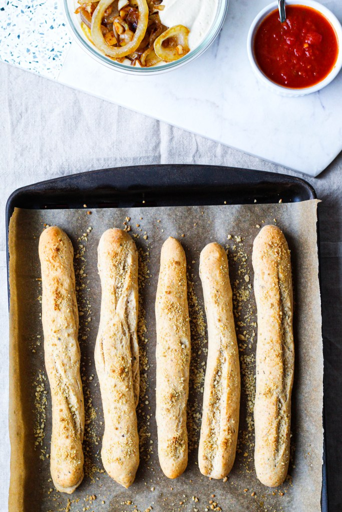 overhead shot of the breadsticks on a baking sheet