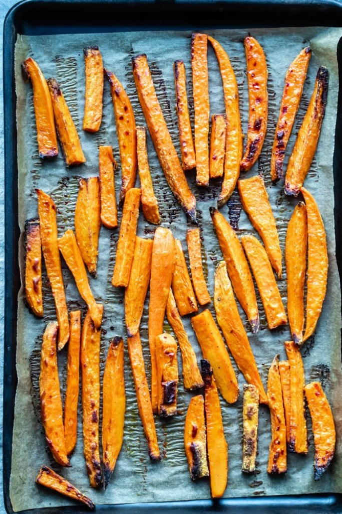overhead shot of the oven fries on a baking sheet