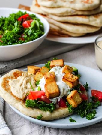 straight on shot of the greek tofu naanwich