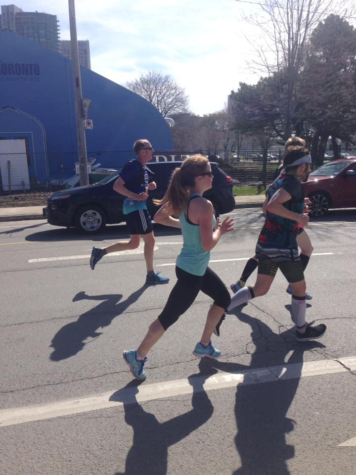 image of Allison running a half marathon in 2019