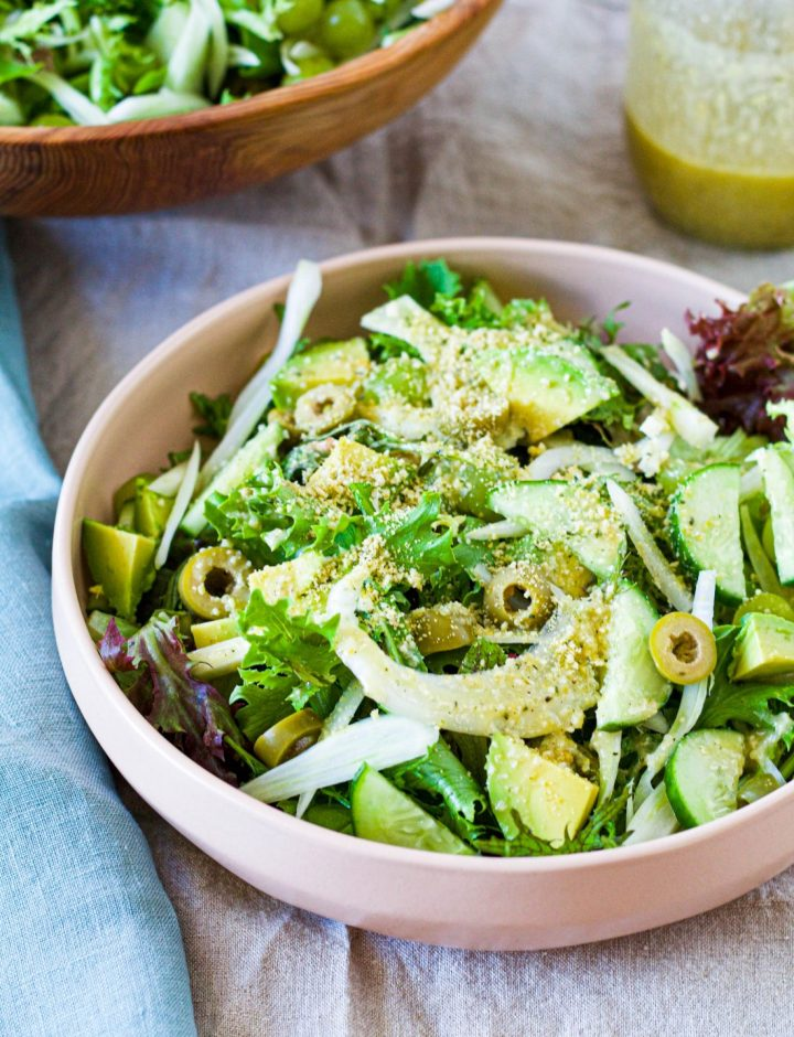 straight on shot of the green power salad in a pale pink bowl