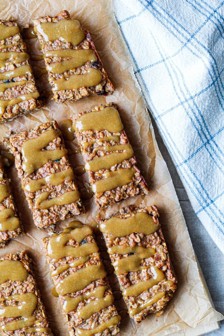 overhead shot of the energy bars on a wooden board with tahini maple drizzle on top