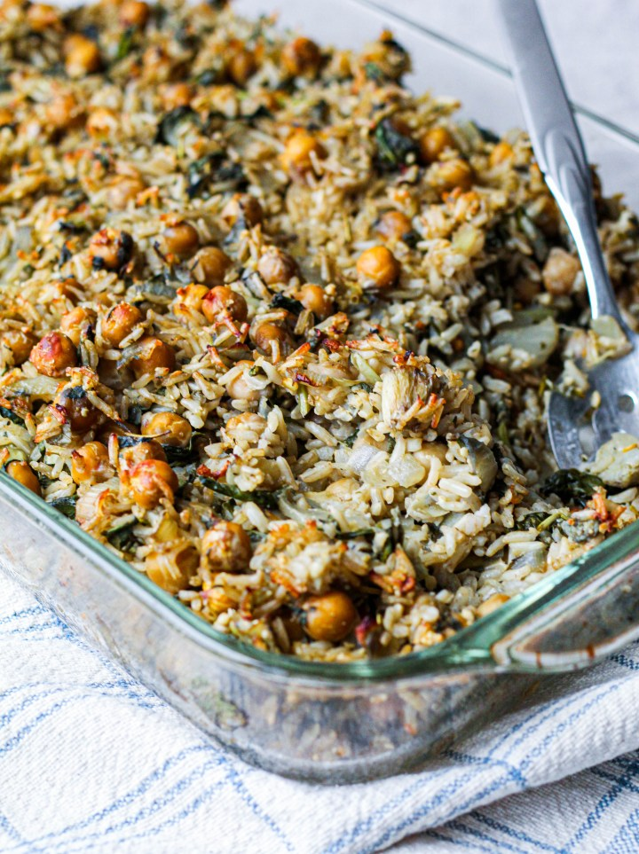 straight on shot of the brown rice chickpea casserole in a pan
