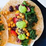 overhead shot of one taco with roasted beets, chickpeas, kale, and avocado sauce.