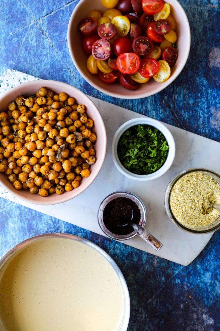 an overhead shot of the za'atar roasted chickpeas, tomatoes, olive paste, and tahini Alfredo sauce