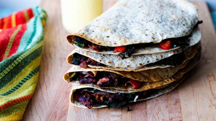 straight on shot of four quesadillas stacked on top of each other