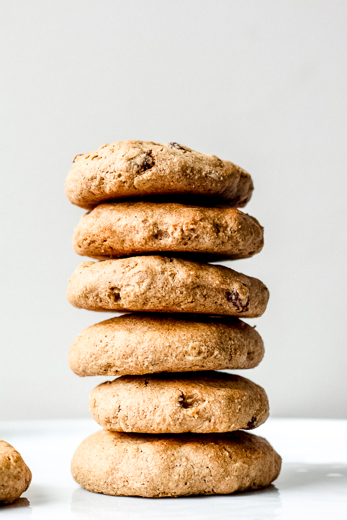straight on shot of a stack of several oil free oatmeal raisin cookies on a white background