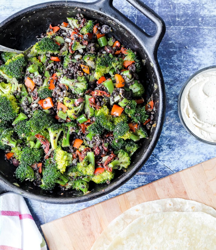 overhead shot of the broccoli and lentils in a cast iron skillet