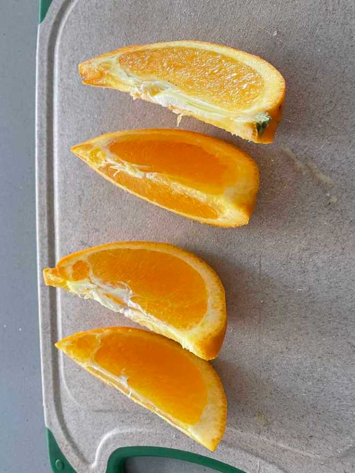 a photo of an orange sliced into wedges, part of my breakfast