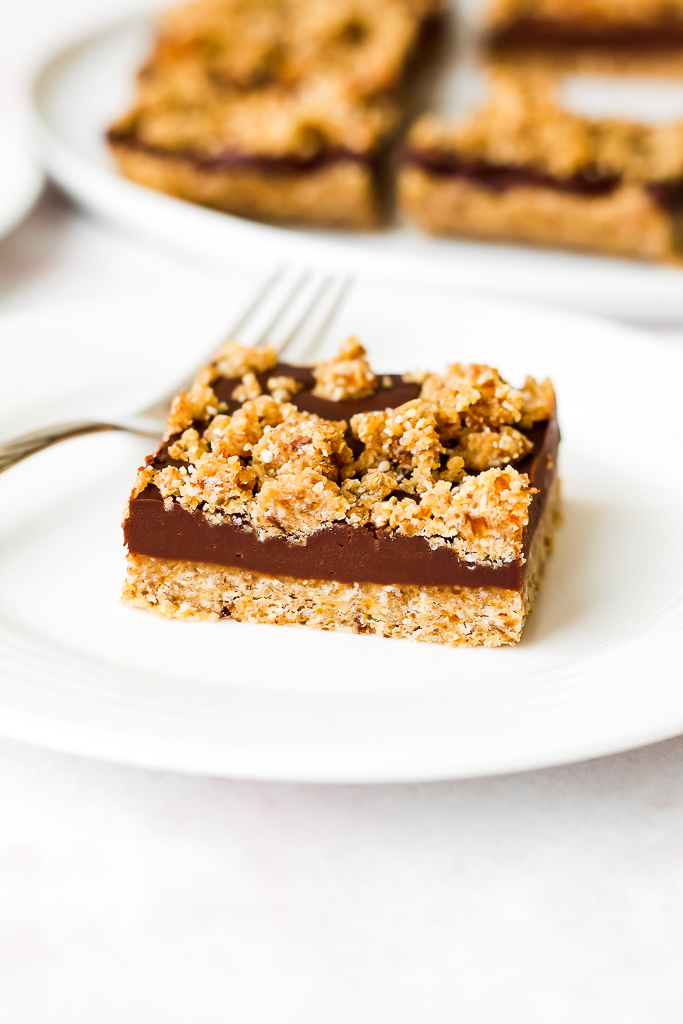 straight on shot of a no bake oat fudge bar on a small white plate