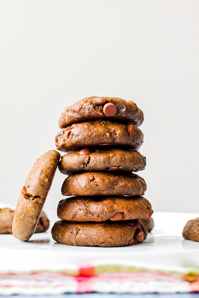 straight on shot of a stack of several vegan double chocolate sunbather cookies on a white plate