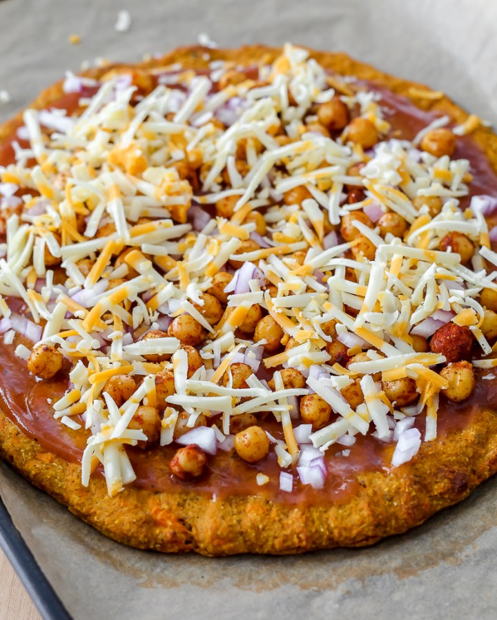 the grated cheese freshly placed on the pizza