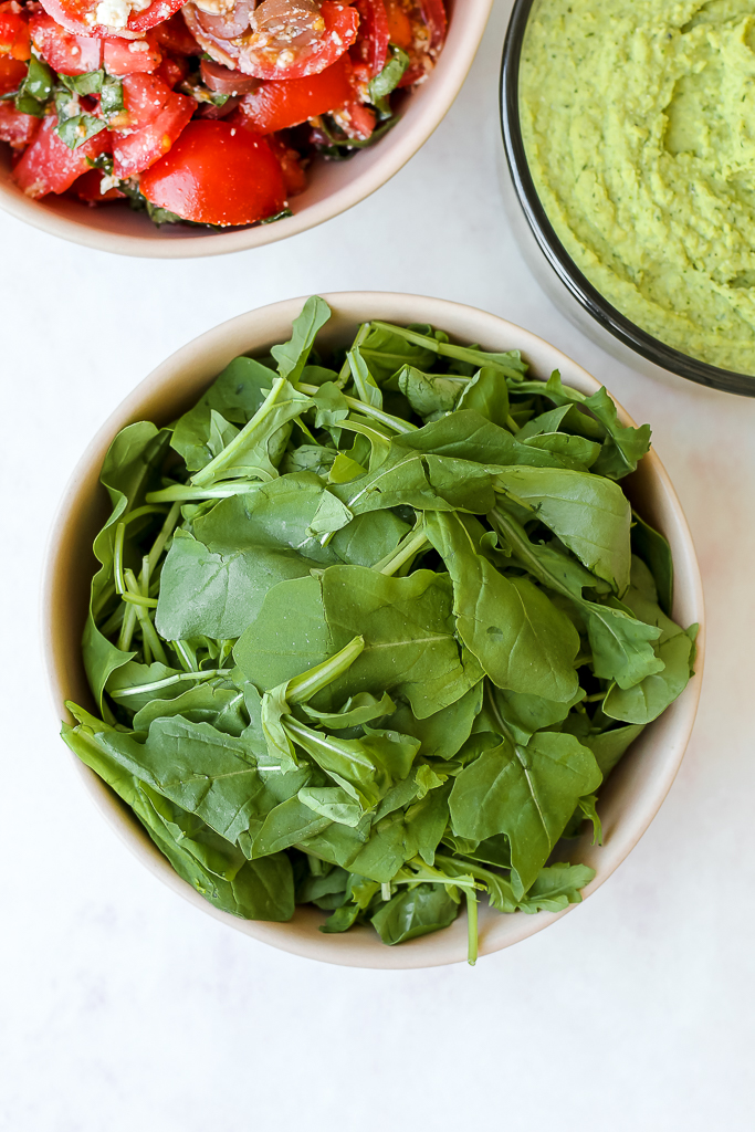 overhead shot of the arugula in a bowl
