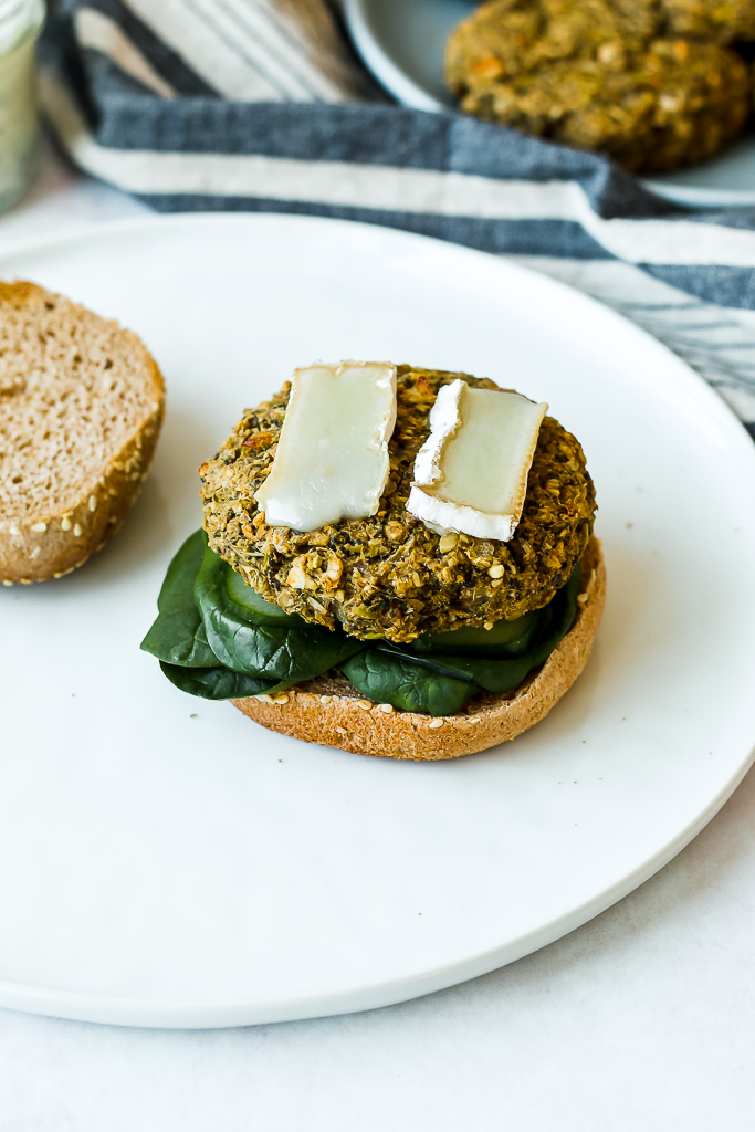 straight on shot of white bean broccoli burger on a sprouted grain bun