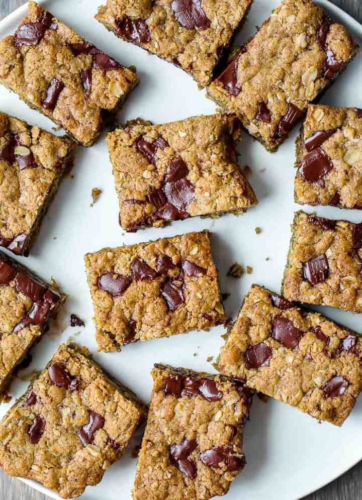 zoomed out overhead shot of the chocolate chunk cookie bars on a white plate