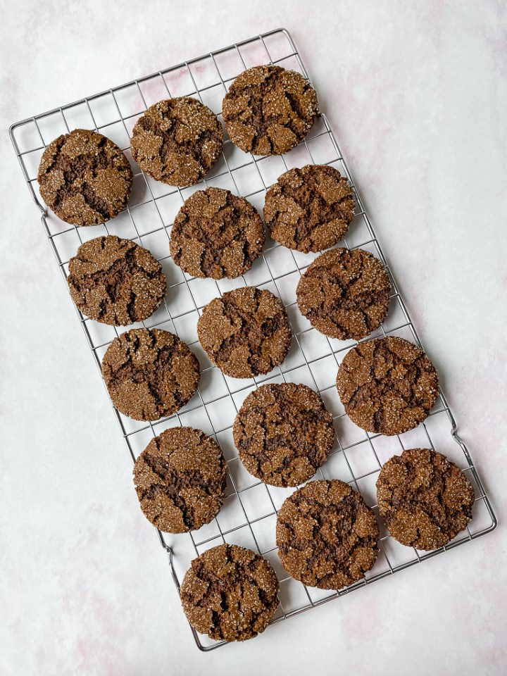 far out overhead shot of the vegan ginger cookies on a wire rack