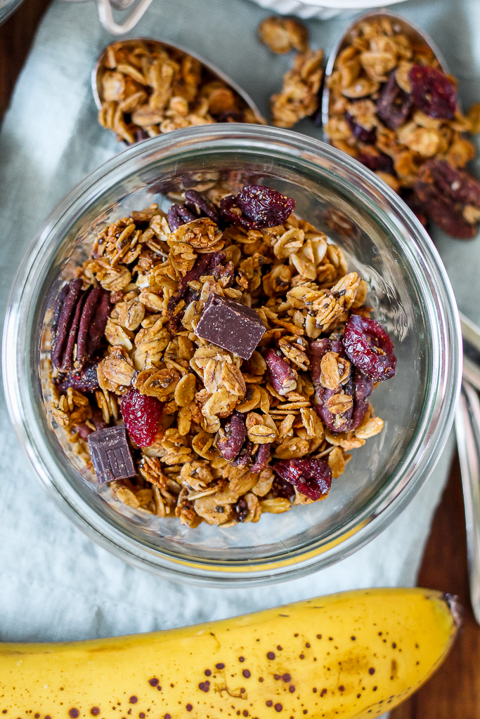 close up overhead photo of the granola on a wooden tray on a blue towel