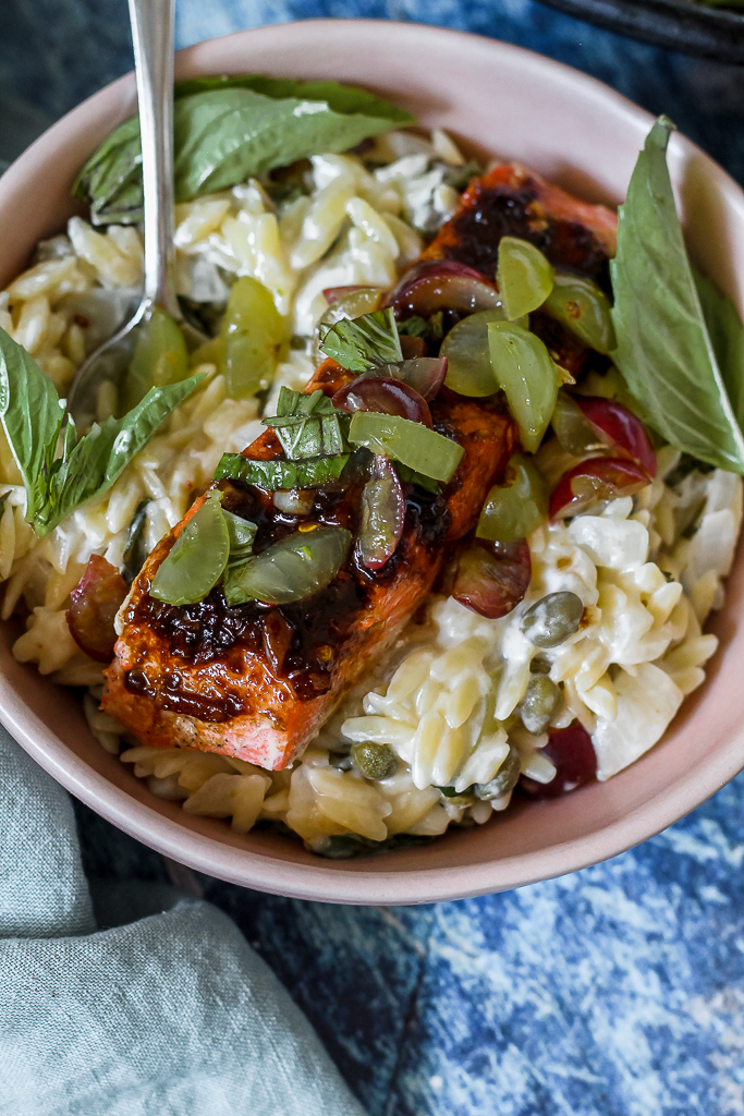straight on shot of a bowl of the salmon and orzo