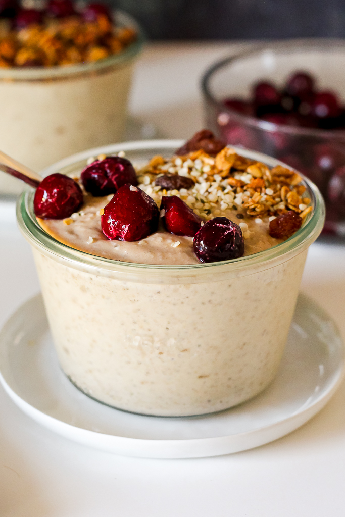 straight on shot of a bowl of quinoa banana breakfast pudding with a spoon in it