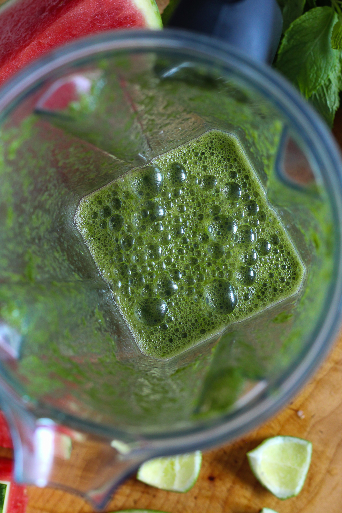 overhead shot of the green juice in a blender