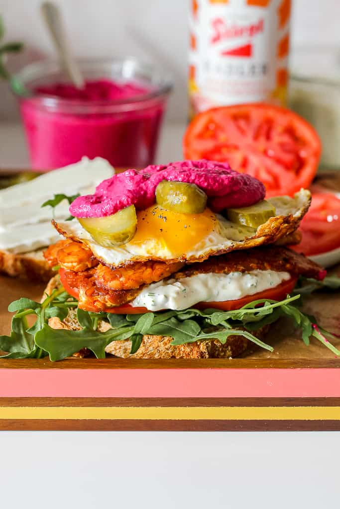 straight on shot of the sandwich with beet pesto on top