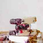 straight on shot of a stack of vegan lemon blueberry cheesecake popsicles