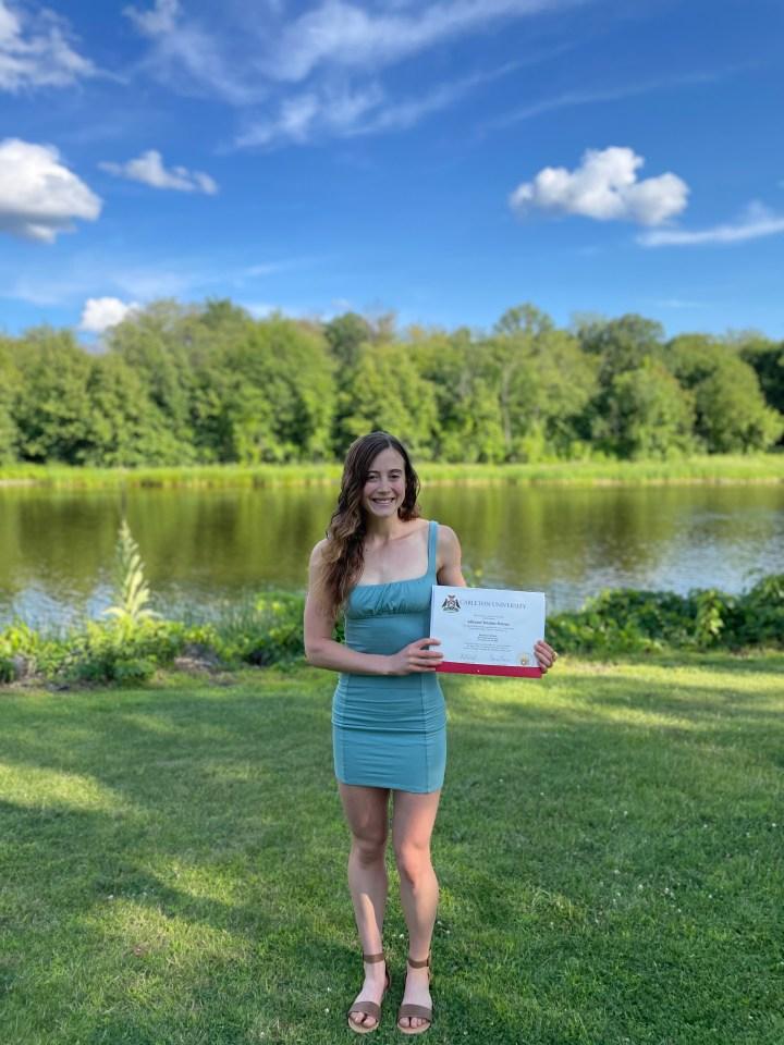 Allison holding her university degree