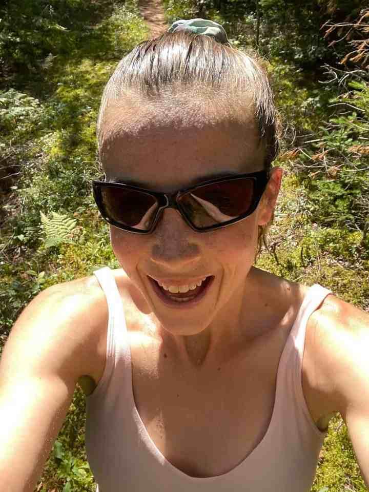 a selfie of Allison on a trail run
