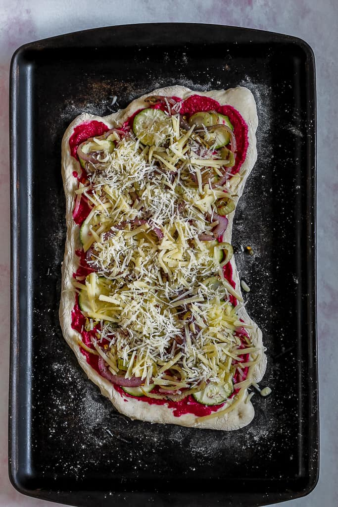 overhead shot of the pizza before going into the oven
