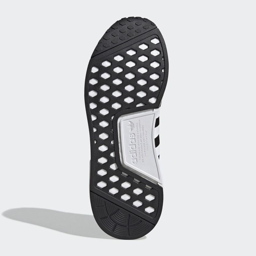 Adidas sneaker with three white stripes