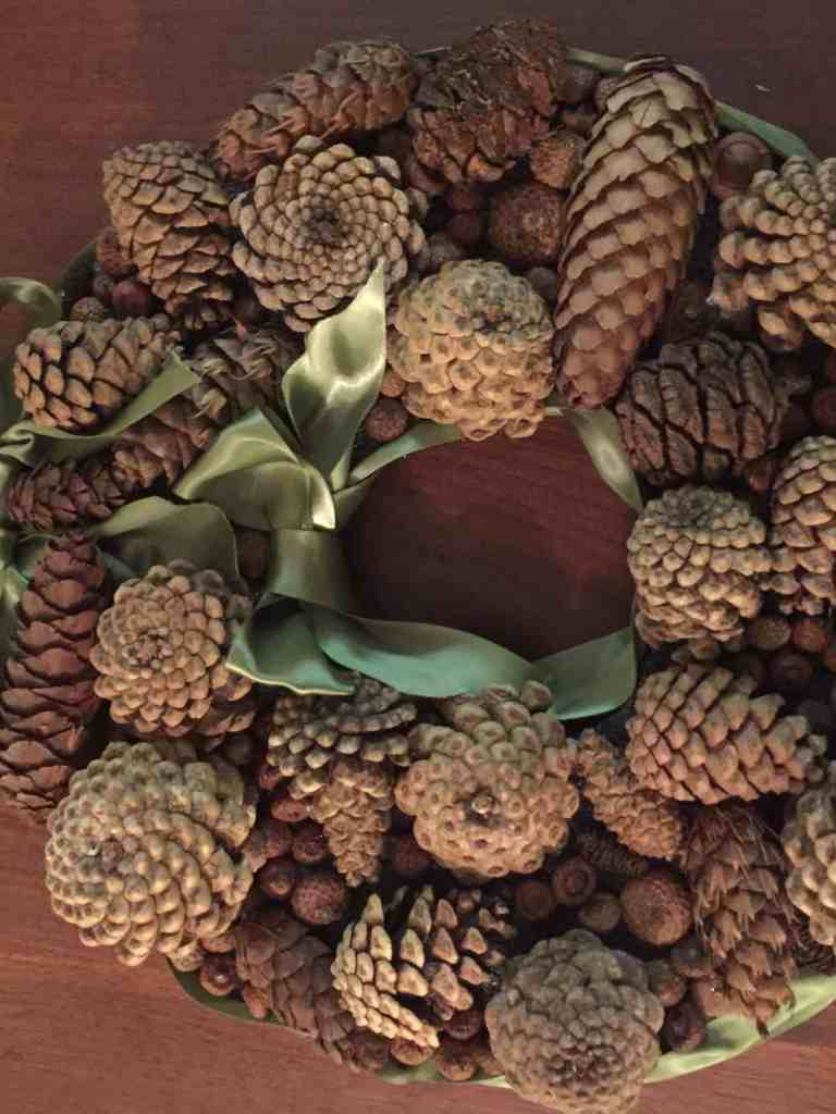diy christmas pine cone wreath tutorial made from upcycled materials
