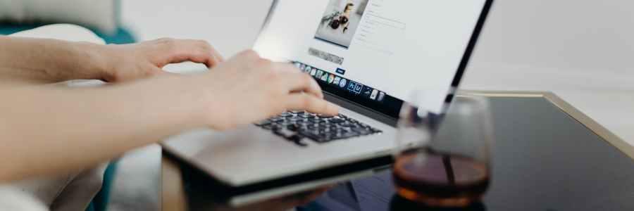 person using macbook laptop