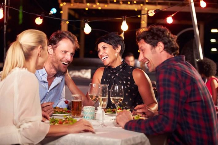 Friends Enjoying Dining at a Restaurant