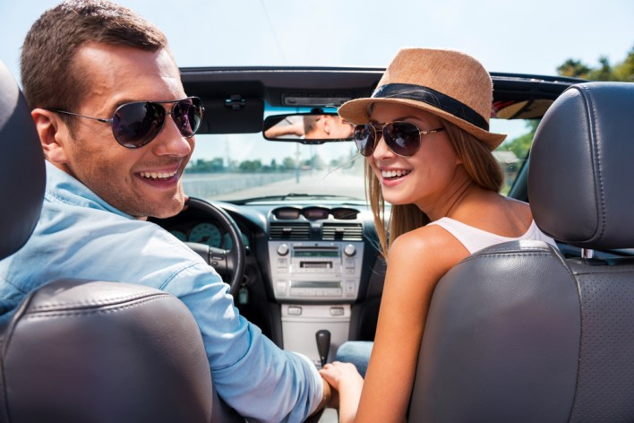 Couple Enjoying Rental Upgrade