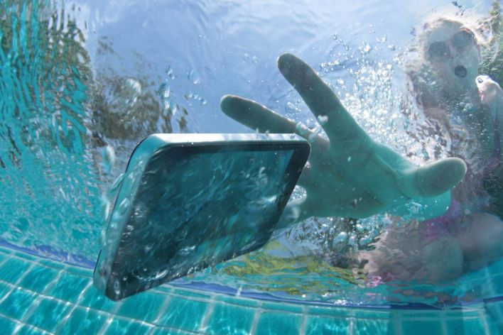 Phone Accident in Pool Covered with Purchase Protection