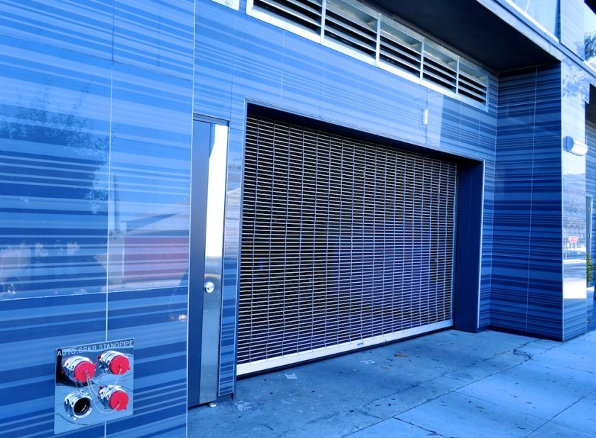Live/works spaces with glass tile garage entrances