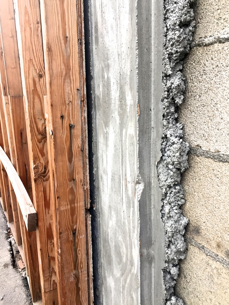 How is the poured concrete attached to the blocks?