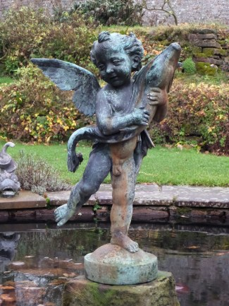 Cherub and dolphin in the lily pond