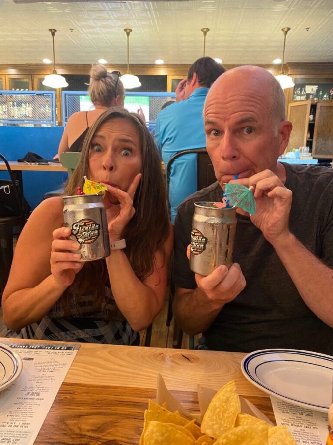 Man and woman drink The Florida Man Cocktail at Heights Taco & Tamale Co.